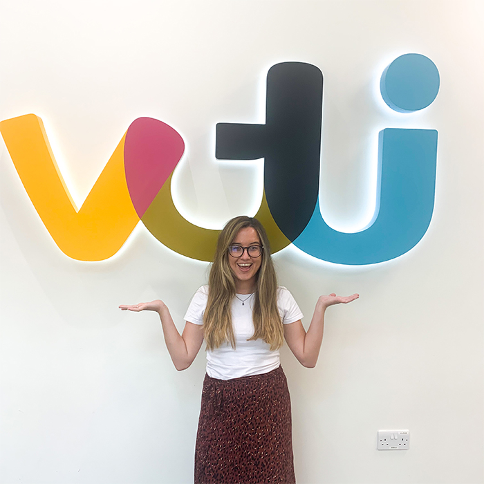 A woman standing in front of a sign saying ITV