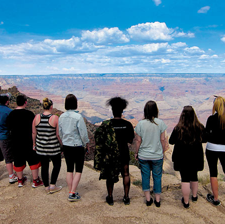 Students looking over the Grand Canyon